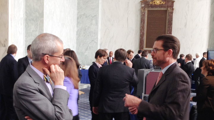Photo (above) taken on Capitol Hill in the Atrium of the Rayburn House Office Building, 2 April 2014, Applied's DE Program Manager, Tom King(r) detailing Thermal Management challenges with Dr. Brian Crone, Congressional Fellow to Congressman Ben Lujan, D-NM 5th District.